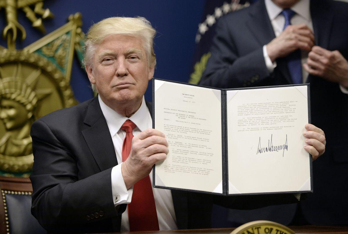 US President Donald Trump signs Executive Orders in the Hall of Heroes at the Department of Defense Friday, Jan. 27, 2017 in Arlington, Va.