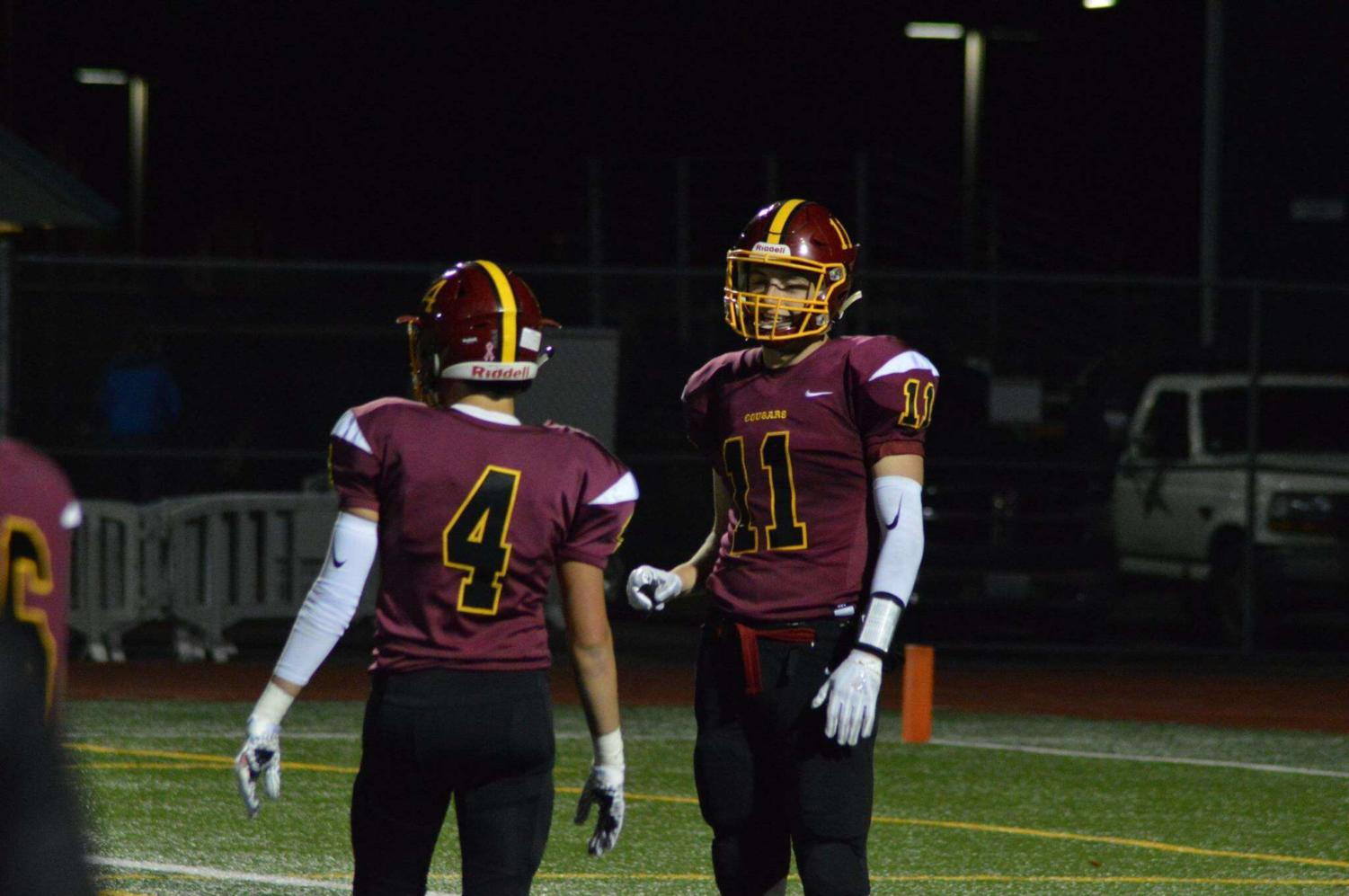 Grant Erikson #11 with Chad Garland #4 during a game.