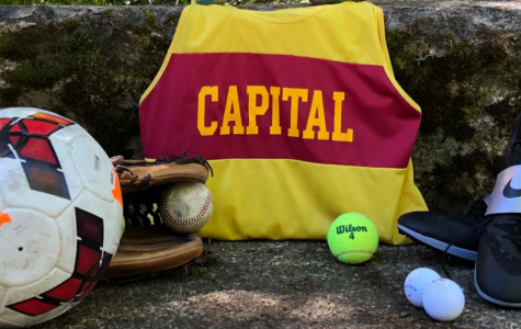 All spring sports equipment is placed in the center surrounding a Capital High School jersey. The camera angle is straight forward.