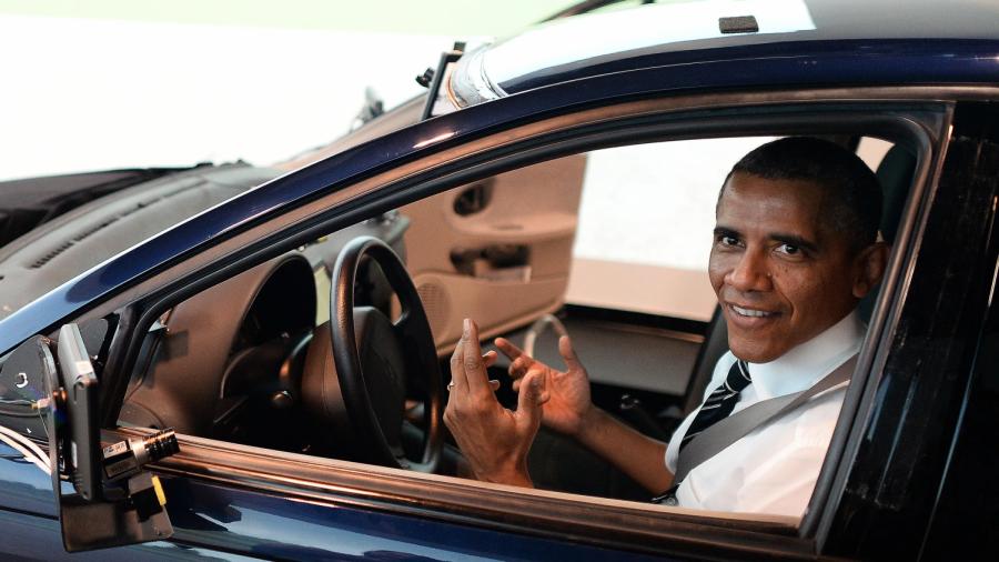 Obama inside of a car