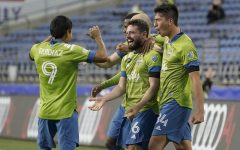 Seattle Sounders players celebrate after scoring a goal.