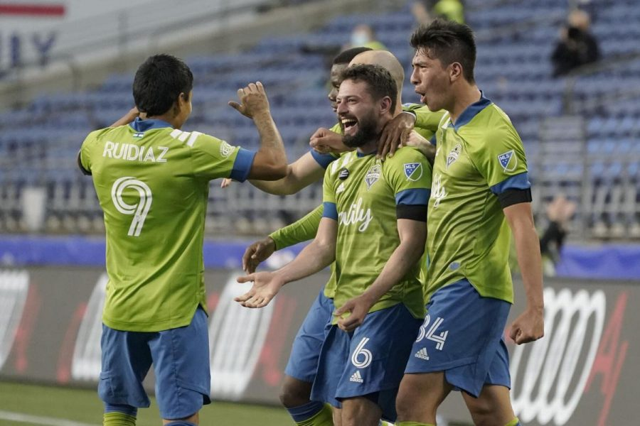 Seattle+Sounders+players+celebrate+after+scoring+a+goal.