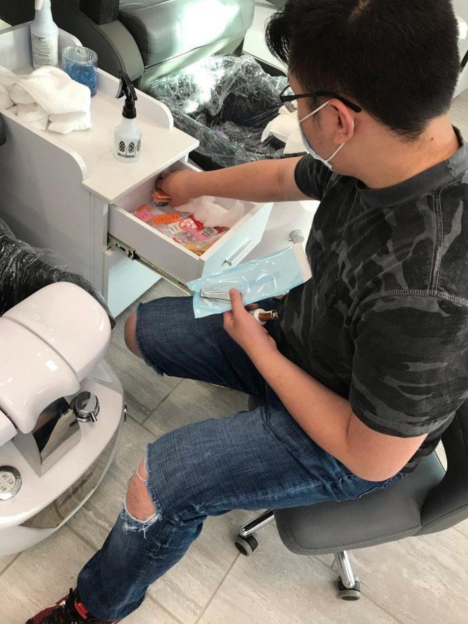 Jason Hang organizing a drawer in the salon